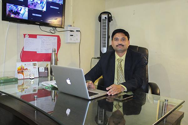 About Dr. Milind Kulkarni